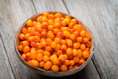 Buckthorn berry basket on wooden background Royalty Free Stock Photos