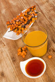Buckthorn juice and oil. Royalty Free Stock Photos