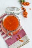 Buckthorn juice with sugar Royalty Free Stock Photos