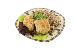 Buckweat with chicken chops amd green salad isolated. On the white background royalty free stock photos