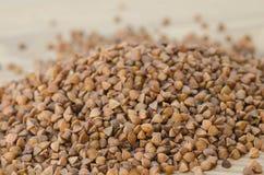 Buckweat. Heap of buckweat on wiiden background royalty free stock image