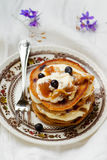 Buckweat pancakes. With blueberry sauce .vintage style .selective focus royalty free stock photography