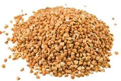 Buckwheat. Handful of buckwheat on white background Stock Photo