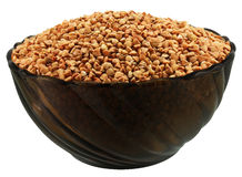 Buckwheat. A bowl of buckwheat (kasha) on white Stock Photos