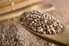 Buckwheat. In a wooden spoon Stock Photography