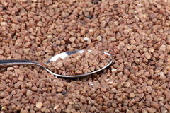 Buckwheat background and teaspoon Royalty Free Stock Image