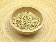 Buckwheat on bamboo plate Royalty Free Stock Photography