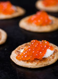 Buckwheat blini with red caviar and sour cream Stock Photography