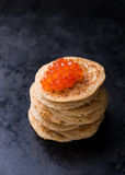 Buckwheat blini with red caviar and sour cream Stock Photo