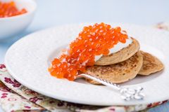 Buckwheat blini with red caviar and sour cream Royalty Free Stock Photos
