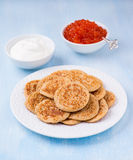 Buckwheat blini with red caviar and sour cream Stock Image