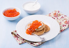 Buckwheat blini with red caviar and sour cream Royalty Free Stock Image