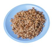 Buckwheat in a plate isolated on white background. buckwheat top view. Healthy food. Buckwheat in a blue  plate isolated on white background. buckwheat top side stock photo