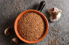Buckwheat in a bowl with garlic Royalty Free Stock Photography