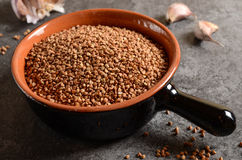 Buckwheat in a bowl with Royalty Free Stock Photography