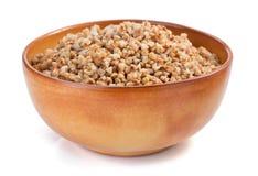 Buckwheat in bowl isolated on white Stock Photos