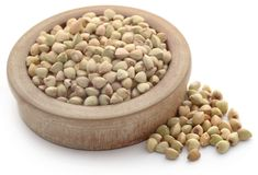 Buckwheat. In a bowl over white background Stock Images