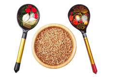 Buckwheat in bowl and russian hand pained spoon isolated on whit Royalty Free Stock Image