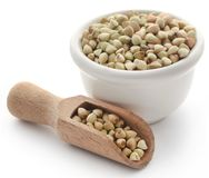 Buckwheat in bowl and scoop. Over white background stock photos