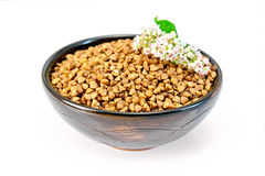Buckwheat in brown bowl and flower Stock Images