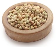 Buckwheat. In a bowl over white background Stock Photos