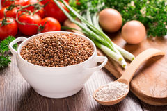 Buckwheat, buckwheat flour, tomatoes, green onions, parsley, eggs. Royalty Free Stock Images