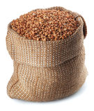 Buckwheat  in burlap bag Royalty Free Stock Images