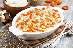 Buckwheat casserole with cottage cheese and dried apricots Royalty Free Stock Photo