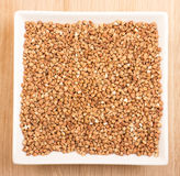 Buckwheat  in ceramic plate Royalty Free Stock Images