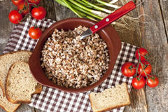 Buckwheat cereal in  bowl on wooden  table Royalty Free Stock Images
