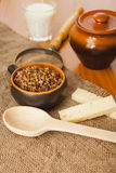 Buckwheat cereal in a ceramic bowl Stock Images