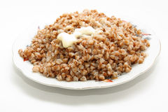 Buckwheat cereal with the cow oil Royalty Free Stock Photos