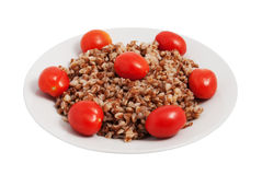 Buckwheat cereal with tomatoes Stock Photos
