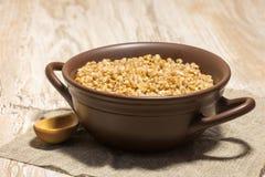 Buckwheat cereal wooden spoon Stock Image