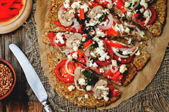 Buckwheat Chia seed pizza crust with mushrooms, tomato, Basil an Royalty Free Stock Images