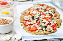 Buckwheat Chia seed pizza crust with mushrooms, tomato, Basil an Stock Images