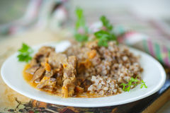 Buckwheat cooked with stewed chicken gizzards Royalty Free Stock Image