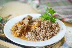 Buckwheat cooked with stewed chicken gizzards Royalty Free Stock Photography