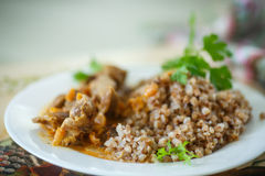 Buckwheat cooked with stewed chicken gizzards Royalty Free Stock Photo
