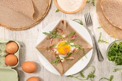Buckwheat crepe. With egg and bacon Royalty Free Stock Images