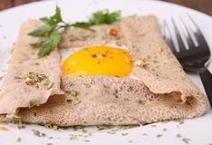 Buckwheat crepe with egg Royalty Free Stock Photo