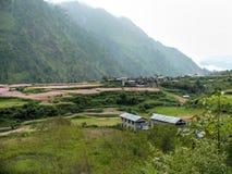 Buckwheat fields and Thamchok village - Nepal Stock Photo