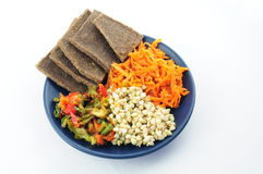 Buckwheat, flax breads,  pepper and carrot on the plate Royalty Free Stock Images