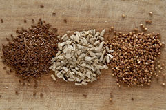 Buckwheat, flax and sunflower seeds Stock Photos