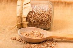 Buckwheat in glass jar Stock Photo