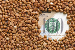 Buckwheat grains on bank note Royalty Free Stock Photography
