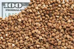 Buckwheat grains on bank note Stock Image