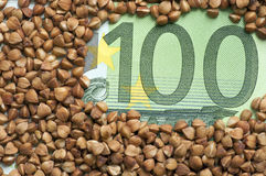 Buckwheat grains on bank note Stock Images