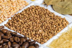 Buckwheat grains close-up in set of groceries Stock Photography