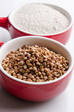 Buckwheat grains and flour Stock Photos